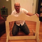 David Glicksman, playing with doll furniture